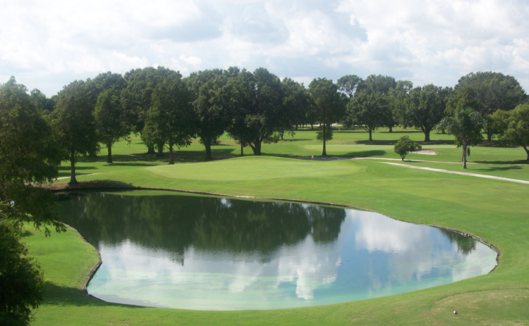 A serene pond is pictured on a sunny day at River Greens Golf Course in Avon Park, Florida